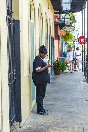 NEW ORLEANS, USA - JULY 17  waitres smokes at the sidewalk a cigarette on July 27, 2013 in New Orleans, USA  Smoking inside a restaurant is fordidden in the US except for special smoking rooms