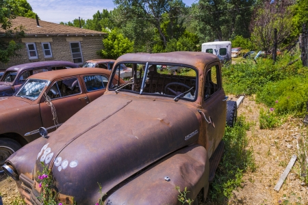 abandoned car: ORDERVILLE, USA - JULY 15: junk yard with old beautiful oldtimers on the route 89 on July 15, 2008 in Orderville, USA. America is a spot for european classic car hunters.