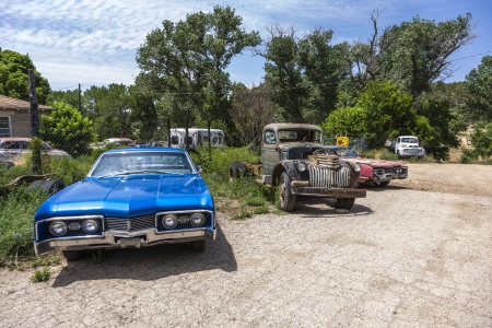 ORDERVILLE, USA - JULY 15: junk yard with old beautiful oldtimers on the route 89 on July 15, 2008 in Orderville, USA. America is a spot for european classic car hunters.