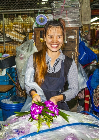 BANGKOK, THAILAND - May 12: women sells fresh orchids at the morning market Pak Khlong Thalat in Chinatown,  May 12, 2009 in Bangkok, Thailand.  The market dates back to the reign of Rama I  (1782–1809).
