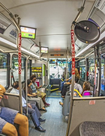 tourist destinations: HOUSTON, USA - JULY 11: tourists travel in the bus  on July 11, 2013 in Houston, USA. The 18-stop, 2.5 mile circular route through downtown onnects cultural centers and tourist destinations and is free for visitors.