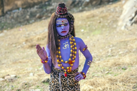 JAIPUR, INDIA - OCTOBER 19  girl dressed as Shiwa begs for an alms  on October 19, 2012 in Jaipur, India  It is a habit that hindus give money to beggars when entering a religious place  Stock Photo - 22264983