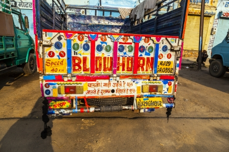 horn like: JAIPUR, INDIA - OCTOBER 12  colorful painted truck on October 19, 2012 in Jaipur, India  Most of the indian trucks are painted with hints like blow horn and speed signs