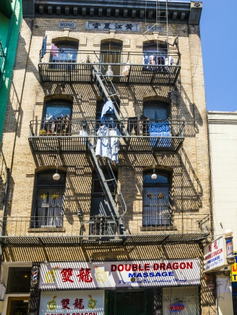 SAN FRANCISCO, USA - JULY 24: iron fire escape is used for drying clothes in Chinatown on July 24, 2008 in San Francisco, USA. San Francisco Chinatown is the largest Chinatown outside of Asia as well as the oldest Chinatown in North America.