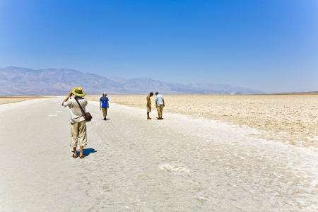 BADWATER, USA - JULY 19: people visit the Saltsee and Badwater basin on July 19, 2008 in Badwater, USA. At 282 feet below sea level, Badwater Basin is the lowest point in the US.