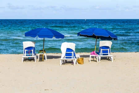 beautiful empty south beach with chairs and parasol in Miami in the morning photo