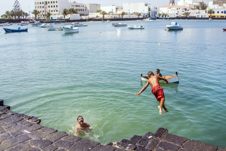 remodelled: ARRECIFE, SPAIN - AUGUST 9  local children play at the charco de San Gines on August 9, 2007 in Arrecife, Spain  The harbor area was remodelled by Canarian architect Cesar Manrique in 1984