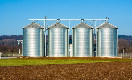 silver silo in rural landscape Stock Photo