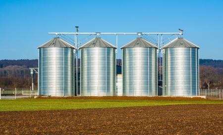 silo: silver silo in rural landscape Stock Photo