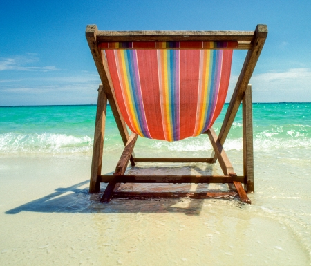 wooden chair at the beach photo