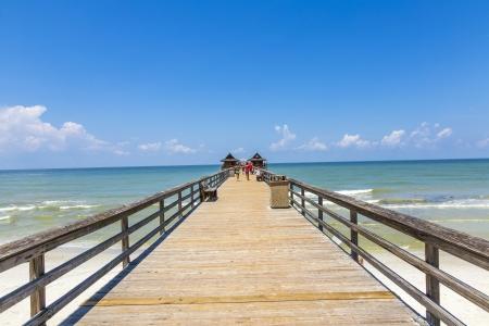 Middag bij Napels pier op het strand Golf van Mexico, Florida Stockfoto