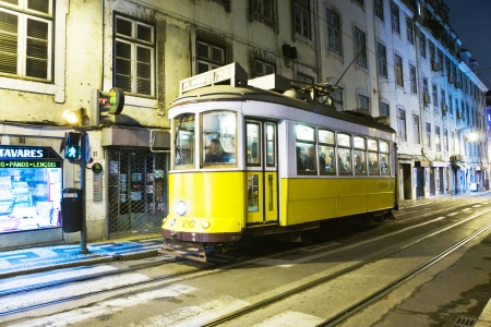 streetcar: Lisbon, Purtugal - December 29, 2008: Traditional yellow tram downtown Lisbon by night in Portugal. In 1901 the first electrical streetcar took up its enterprise and the rope hauling system is still in use.
