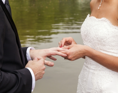 wedding couple are swearing lifetime loyality in the park in the wedding ceremony photo