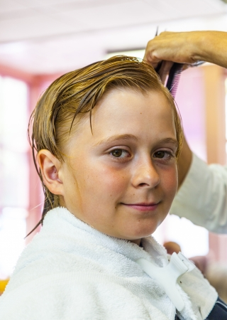 young boys at the hairdresser photo