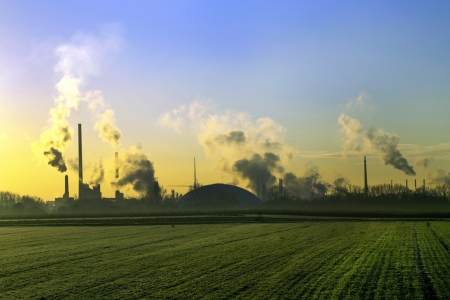 industry landscape in sunrise with smoking chimneys Stock Photo