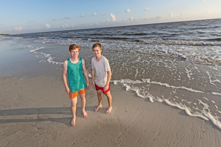 portrait of handsome boys at the beach photo
