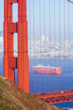 SAN FRANCISCO, USA - JUNE 19: the cargo ship wallenius wilhelmsen passes the golden gate bridge on June 19, 2012 in San Francisco. The golden gate bridge was inaugurated in 1932.