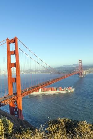 SAN FRANCISCO, USA - JUNE 19: the cargo ship wallenius wilhelmsen passes the golden gate bridge on June 19, 2012 in San Francisco. The golden gate bridge was inaugurated in 1932.
