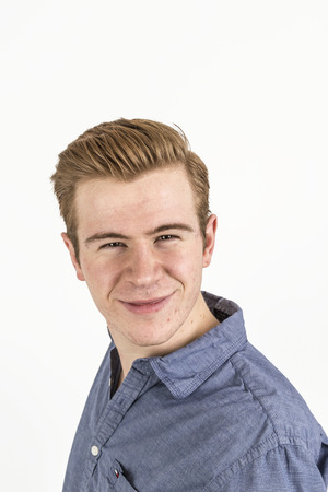 portrait of cool boy with red hair posing in studio photo