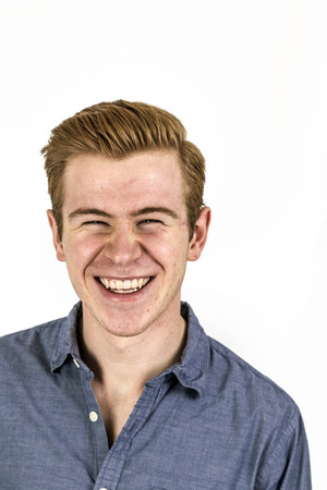 cool boy: portrait of cool boy with red hair posing in studio
