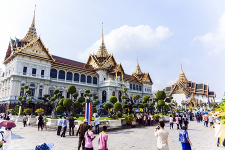 BANGKOK, THAILAND - JAN 4: people visit Chakri Maha Prasat in Grand Palace on January 4, 2010 in Bangkok, Thailand.  The palace was built by King Rama V and completed in 1882. Stock Photo - 25182018
