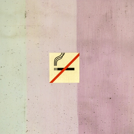 colorful wall structure in stripes with no smoking sign photo