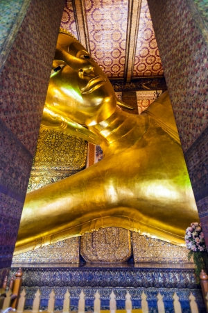 BANGKOK, THAILAND - JANUARY 4: Detail of the Reclining Buddha statue in temple Wat Pho in Bangkok, thailand at January 4, 2010. Statue is 15 m high and 43 m long with his right arm supporting head.