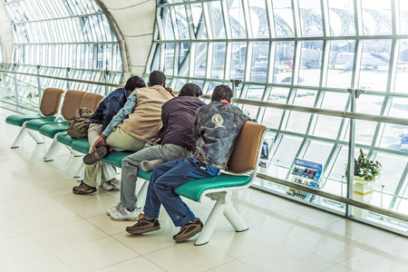 BANGKOK - JAN 5  people wait at gate at Suvarnabhumi International Airport on January 5, 2010 in Bangkok, Thailand  The airport is handling about 45 million passengers annually