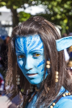 make public: FRANKFURT, GERMANY - OCTOBER 10: Public day at Frankfurt international Book Fair, colorful girl made up as Avatar figure from the film scene and poses for photografers on October 10, 2010 in Frankfurt, Germany.