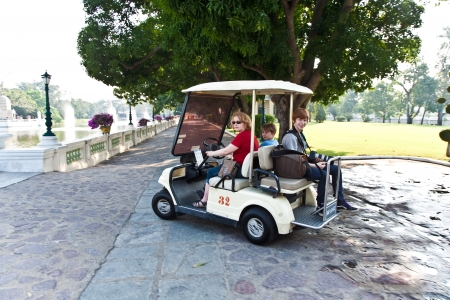 admissions: AYUTTHAYA, THAILAND - DEC 24:  family is using a electric car in  the Thai royal Summer Palace of Bang Pa-in   on December 24, 2009 in Ayutthaja,Thailand. The car is free of charge and avoids CO2 admissions.
