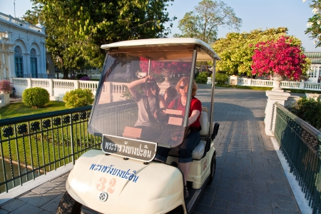 AYUTTHAYA, THAILAND - DEC 24:  family is using a electric car in  the Thai royal Summer Palace of Bang Pa-in   on December 24, 2009 in Ayutthaja,Thailand. The car is free of charge and avoids CO2 admissions.