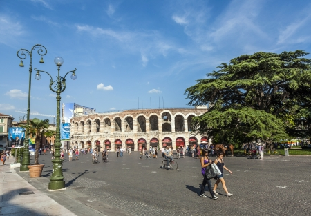 1st century: VERONA, ITALY  - AUG 05: visitors, spectators walking on Piazza BRA outside the old arena on August, 05, 2009 in Verona, Italy. The Arena was built by the Romans in the 1st century AD, in the Augustian period.