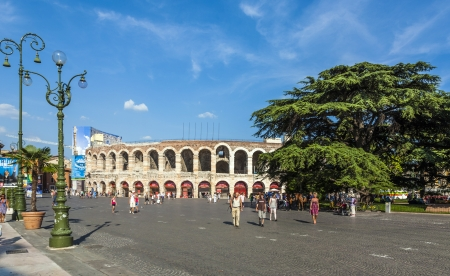 1st century ad: VERONA, ITALY  - AUG 05: visitors, spectators walking on Piazza BRA outside the old arena on August, 05, 2009 in Verona, Italy. The Arena was built by the Romans in the 1st century AD, in the Augustian period.