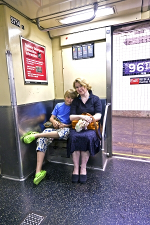 NEW YORK CITY - JULY 11: mother and child sit in metro   on July 11, 2010 in New York City. The first underground line   opened on October 27, 1904 and is the forth busiest nowadays in the world.