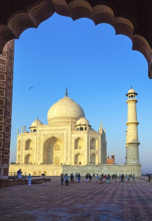 AGRA, INDIA - NOV 16 Unidentified western tourists take pictures from a scenic point of the white marble mausoleum Taj Mahal on November 16, 2011 in Agra, India. 2,5 Mio. local tourists visit the UNESCO World heritage site yearly.