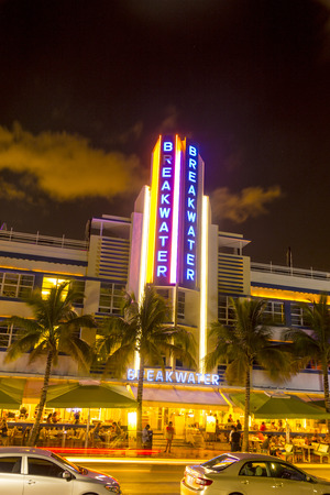 artdeco: MIAMI BEACH - July 31: Night view at Ocean drive on July 31, 2013 in Miami Beach, Florida. Art Deco Night-Life in South Beach at ocean drive is one of the main tourist attractions in Miami. Editorial