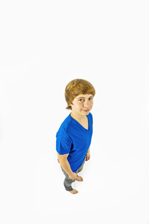 wideangle: portrait of handsome young boy in studio in wideangle perspective