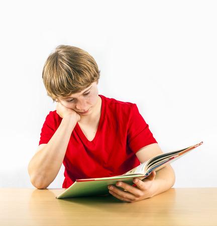 trustful: cute pupil reading in a school book Stock Photo