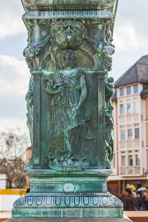 roemer: iron allegory at the fountain of justice in Frankfurt