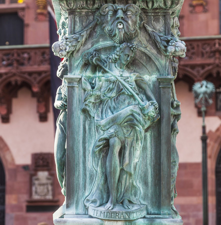 roemerberg: iron allegory at the fountain of justice in Frankfurt