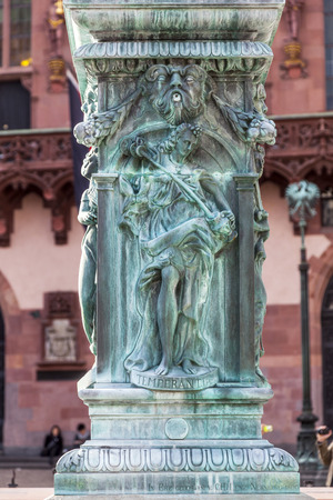 allegory: iron allegory at the fountain of justice in Frankfurt