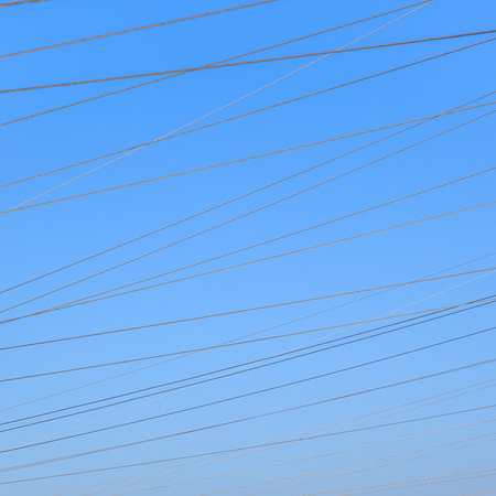 volts: hight voltage tower in rural landscape with blue sky
