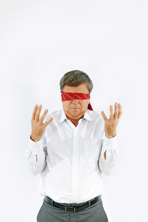 businessman with necktie covering his eyes symbolizing blindness at work Stock Photo