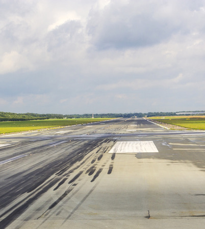 detail of runway with pattern of wheels in the touch down zone photo
