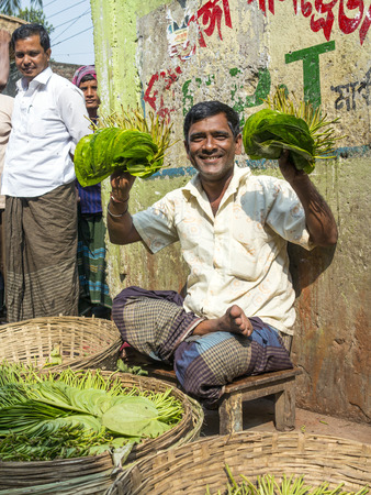 DHAKA, BANGLADESH - NOV 30: people at the old market selling fruits and vegetables on Nov 30, 2012 in Dakha, Bangladesh. 129 million people live on less than USD2 a day.
