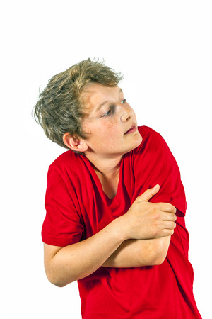 portrait of shy boy with red shirt photo