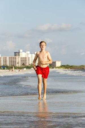 myers: teenager enjoys jogging along the beautiful beach