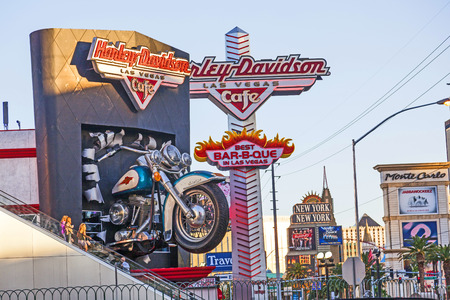 sportster: LAS VEGAS, USA - JULY 15: Harley Davidson Cafe in The Strip on July 15, 2012 in Las Vegas, USA. In the facade there is a 7.1:1 scale replica Sportster weighing 1,200 lbs and measuring 32 feet.
