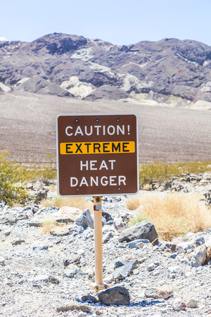 extreme heat: A road sign in Death Valley warning travelers of Caution Extreme Heat Danger Stock Photo