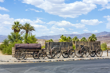 waggon: old waggon at the entrance of the Furnance Creek Ranch in the middle of Death Valley, with these wagons the first men crossed the death valley in the 19th century